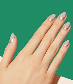 Monochromatic color palettes and minimal geometric designs add cool, sophisticated touches to your office wardrobe without compromising your professional integrity. Here, 14 amazing manis that look perfectly right in a meeting or for drinks after hours.