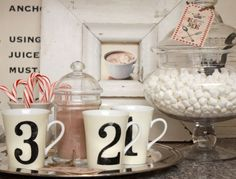 hot chocolate station during Christmas...could do numbers or initials on mugs with my chalkboard Contact paper...Dollar Tree has cute white mugs with a beaded border right now  {fun teacher/neighbor/playmate gift, too!}