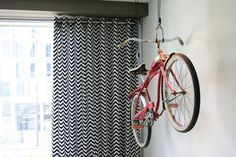 bike rack for apartment hanging rack curtain chevron patterns light colored wall window living room of Bike Rack for Apartment Ideas for More Effective Storage
