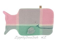 A cute but practical Hot water bottle cover, made from a thick vintage 100% New Zealand wool blanketThe happy little whale hottie cover/ P.J case is made to my own original design, and was inspired by my favorite childhood book. It Features blanket