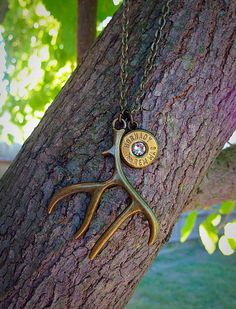 Bullet necklace. Hunting jewelry with deer antler and bullet casing on Etsy, $12.99