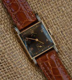 Lord Elgin, Enameled Lugs (1951)  This striking early 1950s Lord Elgin features a black dial complemented with black enamel highlighting on the lugs. The case is 14K yellow gold filled and is paired with an excellent 21 jewel movement.   $225.