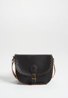 saddle bag with whip stitching in black