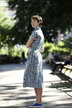 Vintage dress, blue sneakers, short hair. Everything about this photo and this look takes my breath.