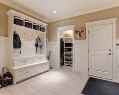 Mudroom. Nice hall tree bench.  Look at those nice pull outs in the base.