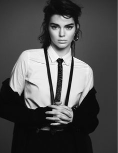 Kendall Jenner // 80s hair, hoop earrings, bold brows, collared button-down shirt, skinny tie, suspenders and a suit.  I LOVE THIS