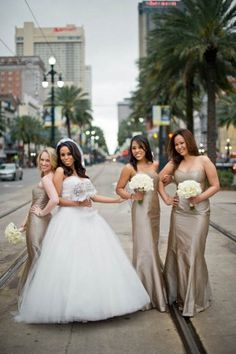 The Bride and Her bridesmaids who are in Champagne-Mocha-dresses, wedding photo