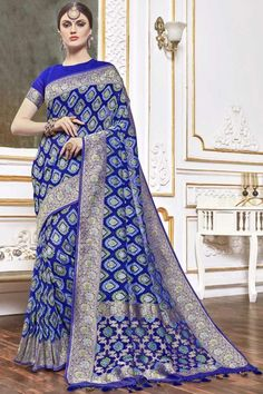 Blue viscose saree with blue viscose blouse. Embellished with woven zari work. Saree with Round Neck, Half Sleeve. It comes with unstitch blouse, it can be stitched to 32 to 58 sizes. #weddingsaree #weddingwearsaree #festivalwear #partywearsaree