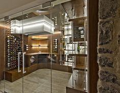custom wine cellar design with glass enclosure