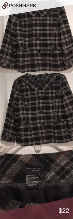 Sandro sportswear plaid jacket Sandro sportswear jacket in plaid with black buttons with silver trim 2 faux pockets in front lined interior good condition with some minor piling on fabric black and gray plaid with a hint of rust line running through Sandro Jackets & Coats Blazers