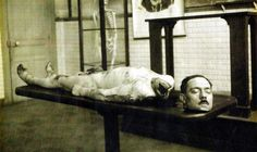 This picture depicts the real work of the guillotine.  The body resting on the morgue slab is Albert Fournier, triple  murderer and rapist, executed by Anatole Deibler, at Tours in  February 1920.