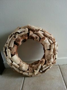 Van stukjes hout - waanzinnig mooi. Robuuste krans Te koop