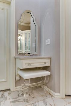 "The countertops are in a Caeserstone, color ""Pebble"". The bench under the vanity is from Bed Bath and Beyond, ""Taymor Urban Modern Acrylic Vanity Bench"". small-make-up-vanity. small-make-up-vanity Ivy House Interiors"
