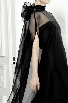 Modern Elegance - long black dress with integrated sheer cape detail; glam chic style // Valentino