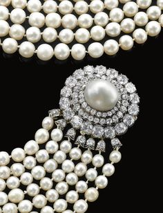 IMPORTANT NATURAL PEARL AND DIAMOND NECKLACE, CIRCA 1880  Composed of seven graduated rows of natural pearls, to a clasp of concentric design set with circular-cut and cushion-shaped diamonds and a natural pearl, length of the shortest row approximately 380mm.