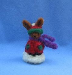 Friendly Little Brown Bunny Warmly Dressed For Playing in The Snow. Needle felted animal figure wearing holiday red and green