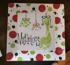 Christmas footprint & paw print mistletoes plate....only child gets pets for siblings. Platter ceramic