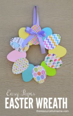 Check out this cute #Easter decor idea with paper egg wreath. Love it! #HomeDecorIdeas @istandarddesign
