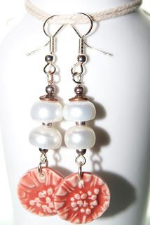 LamplightCrafts:  20/52 Pearl rondelles and porcelain art charm by Chinook Designs.