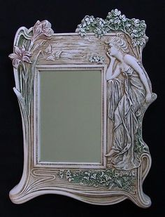 "Art Nouveau Mirror    This elegant 19th century antique depicts a beautiful woman in the flowing style and natural setting that typifies the ""New Art"" that rebelled against the ornateness of the age."