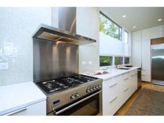 Denver Kitchen With Range Range Hood Stainless Steel Backsplash Behind Range
