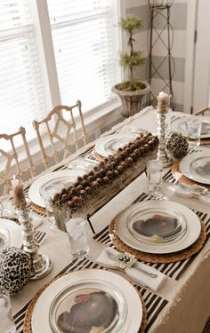 I like the turkey chargers (or turkey picture on a regular charger) under the clear glass plates...over top of the wicker...maybe next Thanksgiving.
