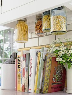 Looking to save some space in your kitchen? Look no further than these DIY tips! We've seen glass jars used as under-shelf storage in the office, but Shannon Quimby, whose DIY-filled kitchen was featured in HGTV magazine, shows us that this space-saving trick works just as well in the kitchen, large or small!