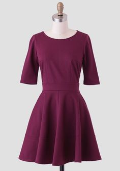 Perfect for a semi-formal occasion, this stunning deep burgundy dress is perfected with a fit-and-flare silhouette in a soft fabric with plenty of stretch. Complete with a three-quarter length sl...