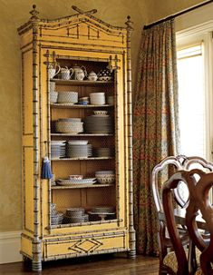 Love this cabinet with the chinoiserie and the chicken wire door...unexpected.