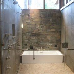 to save on space the shower can be designed to serve as a walk-through to the tub