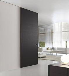 Marsica | Design schuifdeuren | Voor de wand schuivende designdeur | Zwart | Schuifsysteem verwerkt in plafond
