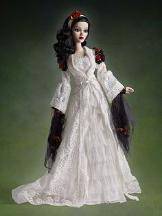 Roses are the perfect touch to this wedding gown with train - Evangeline Ghastly
