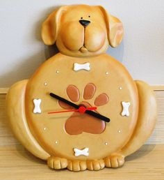 Let your dog count down the minutes until you come home with this pawsitively adorable doggy wall clock!