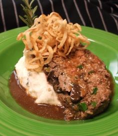Everybody loves a good meatloaf – and we have the best! Mom's Best Meatloaf features black angus beef infused with herbs and sweet onions, sautéed Cremini mushrooms, served over Yukon gold rosemary mashed potatoes with molasses gravy. #SPORT #Seattle #Meatloaf