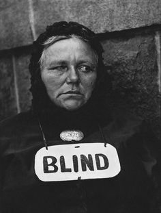 "Paul Strand: Blind, 1916  This seminal image of a street beggar was published in 1917 as a gravure in Stieglitz's magazine ""Camera Work"" and immediately became an icon of the new American photography, which integrated the objectivity of social documentation with the boldly simplified forms of Modernism."