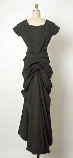 Dress, Evening.  Elsa Schiaparelli (Italian, 1890–1973).  Date: ca. 1939. Culture: French. Medium: wool, brass. Dimensions: Length at CB: 64 3/4 in. (164.5 cm).