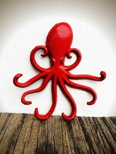 BOLD bright apple red octopus wall hook // nautical beach nursery decor // key jewelry hook // ocean animal cephalopod by BOLDHOUSE on Etsy https://www.etsy.com/listing/213573092/bold-bright-apple-red-octopus-wall-hook