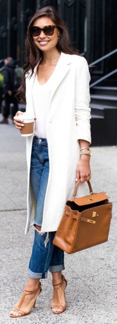 Kat Tanita totally glam bright white overcoat simple white V neck tee pair of distressed jeans tan accessories pair of matching sandals Kat's style Coat: Maje, Jeans: Rag Bone, Bag: Hermes, Heels: Brian Atwood.