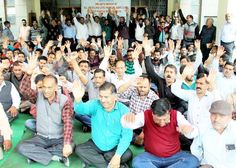 VLWs and MPWs during a protest in the office premises of Directorate of Rural Development Jammu.  -Excelsior/Rakesh