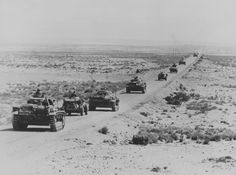 A column of German medium tanks Pz.Kpfw. III Ausf.G and armored cars of the 15th Panzer Division on the march along the highway Libyan Coastal Highway (Via Balbia). Between light armored tanks radiomashina Sd.Kfz.223.