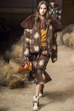 Unless you've been living under a rock the last few months, you've probably noticed that padded jackets have become a [i]thing[/i]. As with most catwalk trends that have a mass appeal, they've had a slight style update to suit the new season. At Coach, Stuart Vevers sent an option down the catwalk flecked with a dainty floral design. We love the way it was worn with a matching skirt.