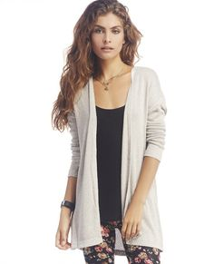"<p>This cute and cozy sweater will take you from summer to fall with ease. It features a soft and lightweight sweater knit body, open front, and a slight high low hemline. Sweater is unlined.</p>  <p>Model is 5'9"" and wears a size small.</p>  <ul> 	<li>72% Rayon / 26% Polyester / 2% Spandex</li> 	<li>Machine Wash</li> 	<li>Imported</li> </ul>"