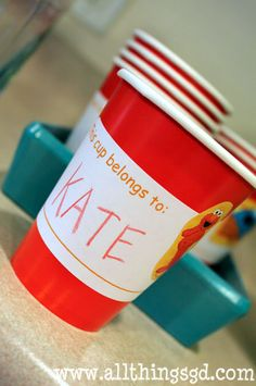 Make your own kiddy drink cups.  Items needed: cups, labels, stickers. So simple!