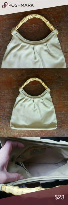 """Cream Leather Handbag Wooden Handles This purse is simply beautiful ! Genuine leather with wooden handles (possibly faux wooden ). 2 pockets compartments and a zipper pocket. Measurements: height 10"""", 13"""" with handles - smallest length 8.5"""", largest length 12"""". Almost no signs of wear ! **I also have another purse that is exactly the same but black ! Bundle and save ! Talbots Bags Clutches & Wristlets"""