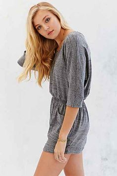 "BDG: Dolman Sleeve Knit Romper in ""Light Grey"" / ""Our favorite cozy romper from UO's own BDG collection. Marled knit featuring a loose-fitting bodice, a cinched waist and cuffed shorts. Finished with low pouch pockets, a crew-neck and 3/4 sleeves."" / $59.00"