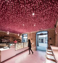 Ideo arquitectura adds undulating pink canopy to madrid pastry shop all images by miguel de guzmán / courtesy of ideo arquitectura