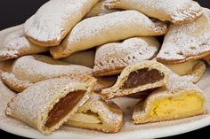 Robiols are pieces of thin flour dough kneaded with oil, lard or egg. They are semicircular in shape and filled with jam, fresh cheese, pastry cream or sweetened spaghetti squash. They might have Jewish origins, as there are similar pastries in Sephardic cuisine called borekas. Robiols are traditionally eaten for Easter