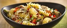 Looking forward to having some Italian-style dinner tonight? Then check out this cheesy ham and vegetables pasta dish that's made in a skillet in just 20 minutes! Pasta Recipes, Chicken Recipes, Cooking Recipes, Ham And Mushroom Pasta, How To Cook Mushrooms, Asiago Cheese, Vegetable Pasta, Prosciutto, Italian Style