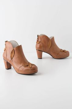 """- Fits true to size - Back zip - Leather upper, insole - Synthetic sole - 2.75"""" leather wrapped heel; 0.5"""" platform - Imported"""