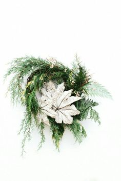 small, green wreath with white flower center